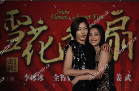 """Gianna Jun, Li Bingbing South Korean actress Gianna Jun, left, and Chinese actress Li Bingbing pose for the photographers during a press conference of a film """"Snow Flower and the Secret Fan"""" as part of the 14th Shanghai International Film Festival Sunday in Shanghai, China"""
