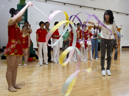 Zhang Ziyi Chinese actress Zhang Ziyi, right, tries a gymnastic ribbon with Wang Yue, a disabled athlete, during a departure ceremony for the Chinese athletes with disabilities at the China Administration of Sports for Person with Disabilities (CASPD) in Beijing, China, . Special Olympic Global Ambassador Zhang will travel to Athens to cheer the Chinese athletes and to promote for Athens Special Olympic World Summer Games coming this June