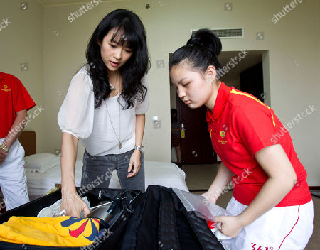 Zhang Ziyi Chinese actress Zhang Ziyi helps Wang Yue, a disabled athlete, pack her luggage before attending a departure ceremony for the Chinese athletes with disabilities at the China Administration of Sports for Person with Disabilities (CASPD) in Beijing, China, . Special Olympic Global Ambassador Zhang will travel to Athens to cheer the Chinese athletes and to promote for Athens Special Olympic World Summer Games coming this June