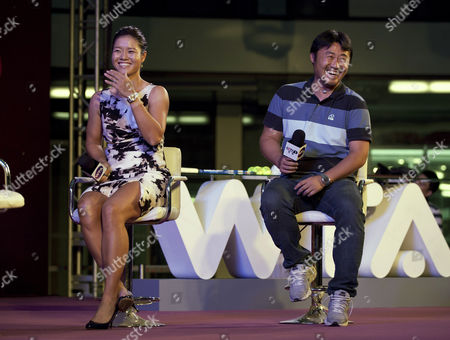 Li Na, Jiang Shan Chinese tennis player Li Na, left, and her husband Jiang Shan smile during a celebration event with her fans organized by Women Tennis Association (WTA) in Beijing, China, . Despite returning home to a hero's welcome, China's first French Open winner Li Na says she intends to keep a low profile and not let the fame change her game