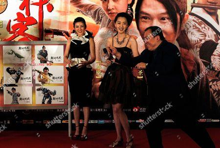 "Wong Jing, Liu Yang, Huang Yi Hong Kong director Wong Jing, right, poses like a mantis near Chinese actresses Liu Yang, center, and Huang Yi during the gala for his movie ""Treasure Inn"" in Beijing, China"