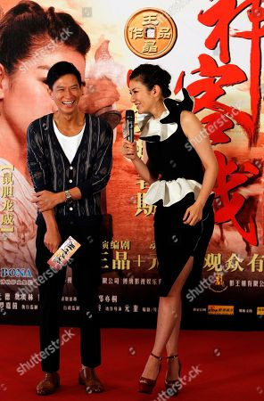 "Huang Yi, Nick Cheung Chinese actress Huang Yi and Hong Kong actor Nick Cheung react at the gala for their latest movie ""Treasure Inn"" in Beijing, China"