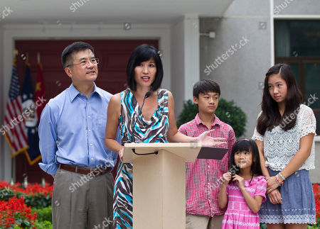 Gary Locke, Mona Lee, Madeline Lee, Dylan James, Emily Nicole Mona Lee, wife of U.S. Ambassador to China Gary Locke, left, introduces her children, from right, Emily Nicole, Madeline Lee, and Dylan James, during a news conference in the courtyard of the ambassador's residence in Beijing, China, . Former U.S. Secretary of Commerce Locke said Beijing and Washington should work together more to tackle global problems, and that he will try to promote greater understanding between the two nations