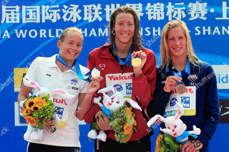 Aurelie Muller, Swann Oberson, Ashley Grace Twichell From left, silver medalist Aurelie Muller of France, gold medalist Swann Oberson of Switzerland and bronze medalist Ashley Grace Twichell of the United States pose during the award ceremony for the women's 5 km open water competition at the FINA Swimming World Championships at Jinshan City Beach in Shanghai, China