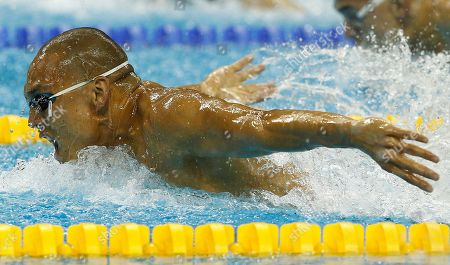 Geoff Huegill Australia's Geoff Huegill competes in a men's 100m Butterfly heat at the FINA Swimming World Championships in Shanghai, China