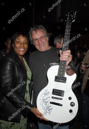 Gloria Jones, widow of Marc Bolan, and Terry Bright who won the signed guitar