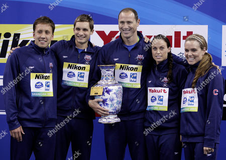 Mark Gangloff, Eric Shanteau, Jason Lezak, Dagny Knutson, Natalie Coughlin The U.S. team members pose together with the trophy for the best team of the FINA 2011 Swimming World Championships in Shanghai, China, . They are, from left, Mark Gangloff, Eric Shanteau, Jason Lezak, Dagny Knutson and Natalie Coughlin
