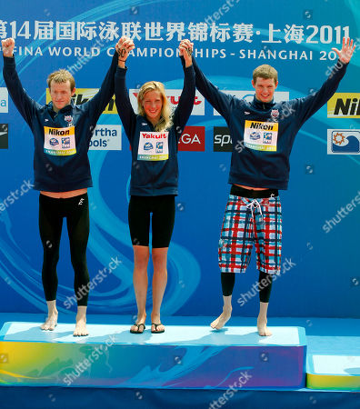 From left, gold medalists United States' Andrew Gemmel, Ashley Grace Twichell and Sean Ryan celebrate during the medal ceremony for the 5km Team open water swimming event at the FINA Swimming World Championships at Jinshan Beach in Shanghai, China