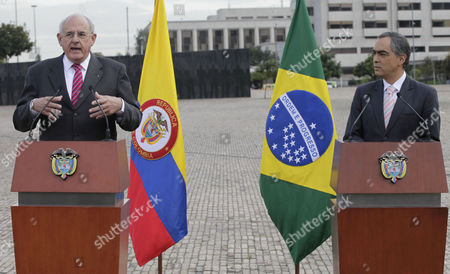 Nelson Jobim, Rodrigo Rivera Brazil's Defense Minister Nelson Jobim, left, talks to the media as Colombia's Defense Minister Rodrigo Rivera listens after a military ceremony in Bogota, Colombia