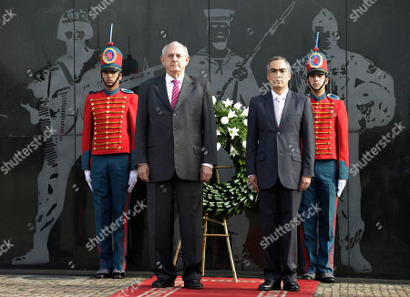 Rodrigo Rivera, Nelson Jobim Colombia's Defense Minister Rodrigo Rivera, right, and Brazil's Defense Minister Nelson Jobim look on after laying a wreath at the monument for soldiers and police killed in the country's war against rebels and paramilitary forces in Bogota, Colombia