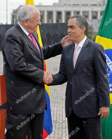Nelson Jobim, Rodrigo Rivera Brazil's Defense Minister Nelson Jobim, left, shakes hands with Colombia's Defense Minister Rodrigo Rivera after a military ceremony in Bogota, Colombia