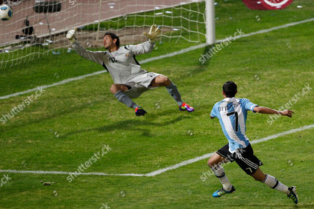 Argentina's Angel Di Maria, right, shoots to score past Costa Rica's goalkeeper Leonel Moreira during a group A Copa America soccer match in Cordoba, Argentina