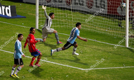 Argentina's Sergio Aguero, right, runs celebrating after he scored a goal against Costa Rica during a group A Copa America soccer match in Cordoba, Argentina, . At top is Costa Rica's goalkeeper Leonel Moreira