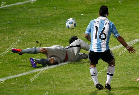 Argentina's Sergio Aguero shoots the ball past Costa Rica's goalkeeper Leonel Moreira to score his second goal during a group A Copa America soccer match in Cordoba, Argentina