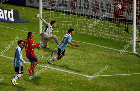 Argentina's Sergio Aguero, right, runs celebrating after he scored a goal against Costa Rica during a group A Copa America soccer match in Cordoba, Argentina, . At top is Costa Rica's goalkeeper Leonel Moreira. Argentina won 3-0