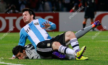 Argentina's Lionel Messi, top, falls over Costa Rica's goalkeeper Leonel Moreira during a Copa America group A soccer match in Cordoba, Argentina, . Argentina won 3-0