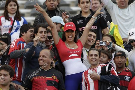 Paraguay's notorious soccer fan Larissa Riquelme poses for the photographers before the start of a Copa America quarterfinal soccer match between Paraguay and Brazil in La Plata, Argentina