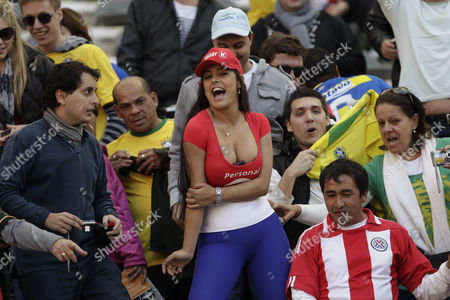Paraguay's notorious soccer fan Larissa Riquelme poses for the photographers before a Copa America quarterfinal soccer match between Paraguay and Brazil in La Plata, Argentina