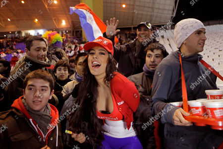 Stock Picture of Paraguay's notorious soccer fan Larissa Riquelme, center, cheers before the start of a Copa America semifinal soccer match between Paraguay and Venezuela in Mendoza, Argentina