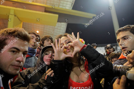 Paraguay's notorious soccer fan Larissa Riquelme cheers before the start of a Copa America semifinal soccer match between Venezuela and Paraguay in Mendoza, Argentina