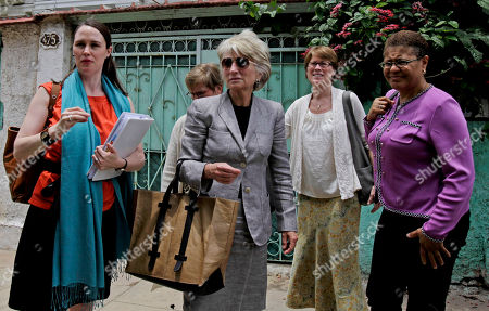 A U.S. women's delegation including Tatman Ryder Savio, a Washington, D.C. lawyer, from left, former democratic Rep. Jane Harman, wearing sunglasses, and Sarah Stephens, director of the Center for Democracy arrive at the Cuban National Center for Sex Education in Havana, Cuba, . A group of U.S. women leaders met with Cuba's President Raul Castro's daughter's, Mariela Castro, for an exchange of ideas on topics including gender, reproductive health and gay rights. The trip was organized by the Center for Democracy in the Americas, which studies U.S. policy toward countries in the region. Woman on right is unidentified