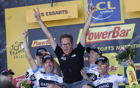 Riders of the Garmin Cervelo cycling team carry team manager Jonathan Vaughters, center, as they celebrate winning the second stage of the Tour de France cycling race, a team trial over 23 kilometers (14.3 miles) starting and finishing in Les Essarts, western France