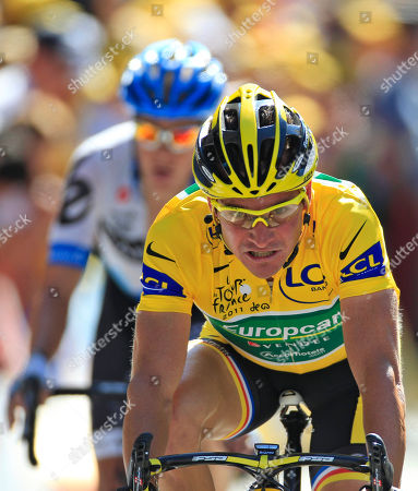 Thomas Voeckler of France, wearing the overall leader's yellow jersey, and Tom Danielson of the US, rear, cross the finish line during the 17th stage of the Tour de France cycling race over 179 kilometers (111.2 miles) starting in Gap, France, and finishing in Pinerolo, Italy