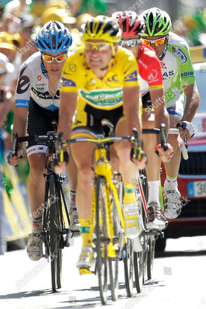 Tom Danielson of the US, left, Thomas Voeckler of France, wearing the overall leader's yellow jersey, Haimar Zubeldia of Spain, second right, and Ivan Basso of Italy, right, cross the finish line during the 17th stage of the Tour de France cycling race over 179 kilometers (111.2 miles) starting in Gap, France, and finishing in Pinerolo, Italy