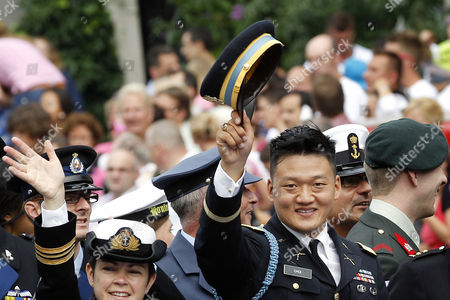 """Lt. Dan Choi, a discharged openly gay U.S. Army veteran who has been an outspoken critic of the military's """"don't ask, don't tell"""" policy takes part in the Gay Pride canal parade in Amsterdam, The Netherlands, . The Dutch Defense Ministry is sponsoring a boat in the annual festival for the first time this year, underscoring the long-standing policy of accepting of homosexuals in the military, starkly contrasting with the """"Don't Ask, Don't Tell"""" (DADT) policy of the US military"""