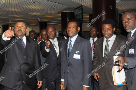 Jean Ping, left, Chairman of the African Union and Teodoro Obiang Mbasogo, center President of Equatorial Guinea arrive at the Economic Commission of Africa, ECA, in Addis Ababa Ethiopia, to attend the pledging conference on Somalia famine