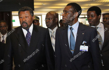 Jean Ping, left, Chairman of the African Union and Teodoro Obiang Mbasogo, right, President of Equatorial Guinea arrive at the Economic Commission of Africa, ECA, in Addis Ababa Ethiopia, to attend the pledging conference on Somalia famine