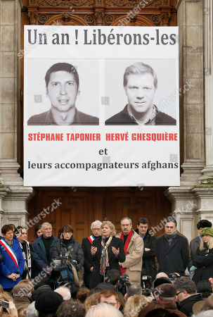 """Herve Ghesquiere, Stephane Taponier Showing Former hostage and journalist Florence Aubenas, center, delivers a speech during a gathering in support of French TV journalists Herve Ghesquiere and Stephane Taponier, who were kidnapped a year ago east of Kabul, Afghanistan, in front of Paris city hall. The banner in back, reads: """"One year! Let us free them and their Afghan fixers"""". The French government announced, that the two hostages have been freed after being held 547 days"""
