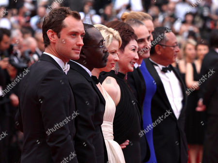 Jude Law, Mahamat Saleh Haroun, Linn Ullmann, Nansun Shi, Olivier Assayas, Uma Thurman, Johnnie To From left, jury members Jude Law, Mahamat Saleh Haroun, Linn Ullmann, Nansun Shi, Olivier Assayas, Uma Thurman and Johnnie To arrive for the closing ceremony at the 64th international film festival, in Cannes, southern France