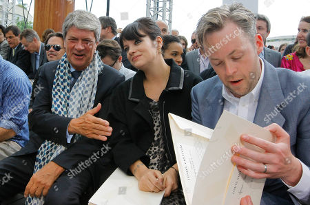 Yves Carcelle, Lily Allen, Sam Cooper Yves Carcelle, left, Chairman and CEO of Louis Vuitton, British singer Lily Allen, center, and her husband Sam Cooper are seen ahead of the Louis Vuitton Men's Spring-Summer 2012 collection, presented in Paris
