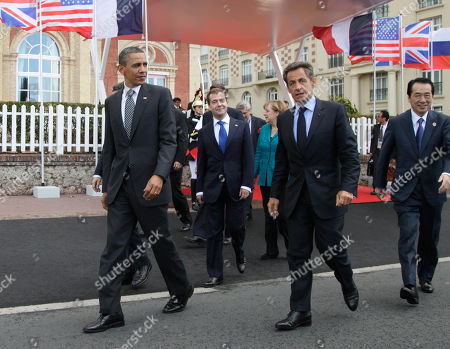 Nicolas Sarkozy, Barack Obama, Angela Merkel, Naoto Kan, Dmitry Anatolyevich Medvedev From left, President Barack Obama, Russian President Dmitry Medvedev, German Chancellor Angela Merkel, French President Nicolas Sarkozy and Japan's Prime Minister Naoto Kan, walk together to the first plenary session at the G8 Summit, in Deauville, France
