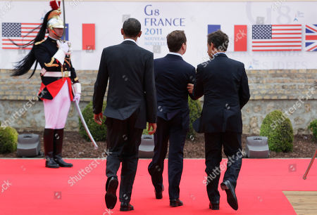 Stock Photo of Nicolas Sarkozy, Barack Obama, Dmitry Anatolyevich Medvedev From left, President Barack Obama, Russian President Dmitry Medvedev, and French President Nicolas Sarkozy, leave an arrival ceremony at the G8 Summit, in Deauville, France