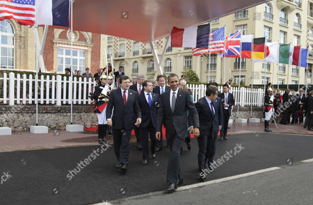 Stock Image of Jose Manuel Barroso, Barack Obama, Nicolas Sarkozy, Russian Federation Dmitry Anatolyevich Medvedev, David Cameron, Stephen Harper From left, European Commission President Jose Manuel Barroso, Canadian Prime Minister Stephen Harper, Russian President Dmitry Medvedev, British Prime Minister David Cameron, President Barack Obama, and French President Nicolas Sarkozy walk together to the first plenary session at the G8 Summit, in Deauville, France