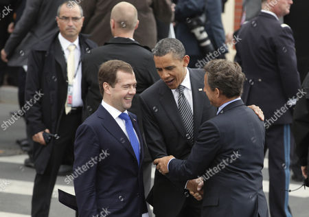 Stock Picture of Nicolas Sarkozy, Barack Obama, Dmitry Anatolyevich Medvedev Russian President Federation Dmitry Medvedev, left, and President Barack Obama are greeted by French President Nicolas Sarkozy as they arrive at the G8 Summit, in Deauville, France
