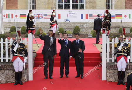 Nicolas Sarkozy, Barack Obama, Dmitry Anatolyevich Medvedev From left, President Barack Obama, Russian President Dmitry Medvedev, and French President Nicolas Sarkozy wave for photographers as they arrive at the G8 Summit, in Deauville, France