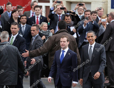 Barack Obama, Dmitry Anatolyevich Medvedev President Barack Obama, right, and Russian President Dmitry Medvedev walk together as they arrive at the G8 Summit, in Deauville, France