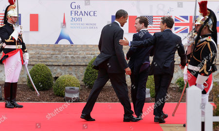 Nicolas Sarkozy, Barack Obama, Dmitry Anatolyevich Medvedev From left, President Barack Obama, Russian President Dmitry Medvedev, and French President Nicolas Sarkozy, leave an arrival ceremony at the G8 Summit, in Deauville, France