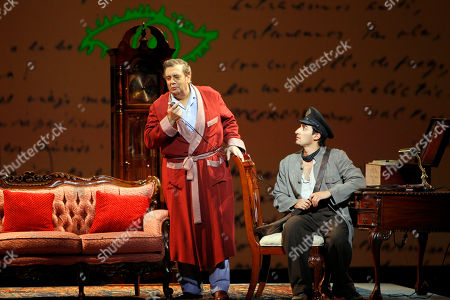 """Placido Domingo, Charles Castronovo Celebrated tenor Placido Domingo, left, who plays Chilean poet Pablo Neruda, and Charles Castronovo perform during """"Il Postino"""" by the opera's late composer, Daniel Catan, at Paris' Theatre du Chatelet, in Paris, . """"Il Postino"""" is adapted from the award-winning 1994 movie by Michael Radford, itself an adaptation of the novel """"Ardiente Paciencia"""" by Antonio Skarmeta"""