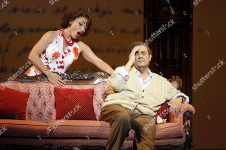 """Placido Domingo, Cristina Gallardo Domas Celebrated tenor Placido Domingo, right, who plays Chilean poet Pablo Neruda, and Cristina Gallardo Domas, who plays his wife Matilde, perform during """"Il Postino"""" by the opera's late composer, Daniel Catan, at Paris' Theatre du Chatelet, in Paris, . """"Il Postino"""" is adapted from the award-winning 1994 movie by Michael Radford, itself an adaptation of the novel """"Ardiente Paciencia"""" by Antonio Skarmeta"""