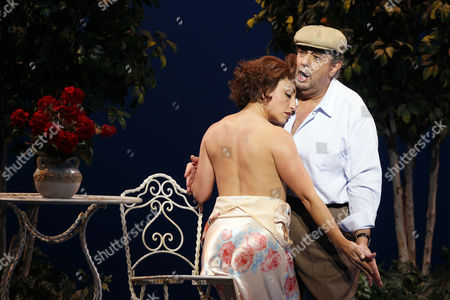 """Stock Photo of Placido Domingo, Cristina Gallardo Domas Celebrated tenor Placido Domingo, right, who plays Chilean poet Pablo Neruda, and Cristina Gallardo Domas, who plays his wife Matilde, perform during """"Il Postino"""" by the opera's late composer, Daniel Catan, at Paris' Theatre du Chatelet, in Paris, . """"Il Postino"""" is adapted from the award-winning 1994 movie by Michael Radford, itself an adaptation of the novel """"Ardiente Paciencia"""" by Antonio Skarmeta"""