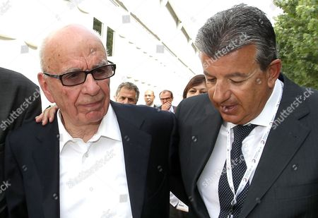 Rupert Murdoch, Tarak Ben Ammar Media magnate Rupert Murdoch, left,and Tunisian producer Tarak Ben Ammar, right, talk at the e-G8 conference, gathering Internet and information technologies leaders and experts, in Paris, . The conference of top digerati is billed as the first of its kind, being held in connection with Group of Eight powerful nations, whose leaders are holding a summit in the Normandy resort town of Deauville on Thursday and Friday
