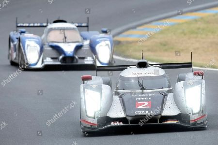 The Audi R18 TDI No2 driven by Benoit Treluyer of France, Andre Lotterer of Germany and Marcel Fassler of Switzerland is seen in action ahead of the Peugeot 908 No7 driven by british Anthony Davidson, Marc Gene of Spain and Alexander Wurz of Austria during the 79th 24-hour Le Mans endurance race, in Le Mans, western France