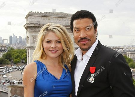 Lionel Richie, Celyne Durand U.S. musician Lionel Richie, right, poses with French actress Celyne Durand after he received the insignia of the Legion of Honor in front of The Arc of Triumph on the Champs Elysees, in Paris