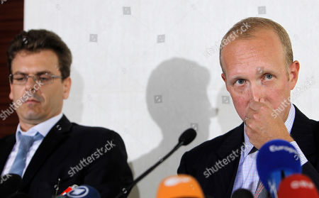 Douglas Wigdor, Thibault de Montbrial Nafissatou Diallo's U.S. attorney Douglas Wigdor, right, and French lawyer Thibault de Montbrial attend a press conference in Paris, . Lawyers for the maid who accused Dominique Strauss-Kahn of attempted rape say she's being treated like a suspect, and that dropping the case against the ex-International Monetary Fund chief will have a chilling effect on victims of sex crimes