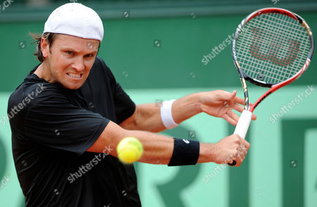Stock Picture of Robert Kendrick United States' Robert Kendrick returns the ball to Spain's Guillermo Garcia-Lopez during their first round match of the French Open tennis tournament, at the Roland Garros stadium in Paris, Sunday, May, 22, 2011