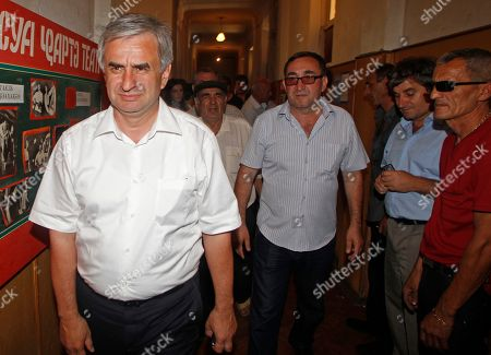 Raul Khadzhimba One of the three presidential hopefuls, opposition leader Raul Khadzhimba, left, walks on the last day of his election campaign in Sukhumi capital of the Georgian breakaway region of Abkhazia, . The elections were announced for Friday, August 26 following the death of President Sergei Bagapsh in May. All the three hopefuls are seasoned pro-Kremlin politicians opposed to reunification with the central Georgian government